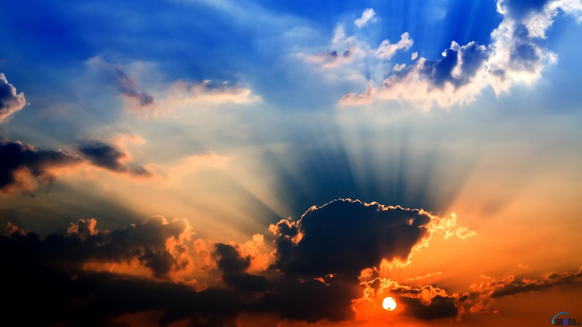 6937804-sun-rays-through-clouds