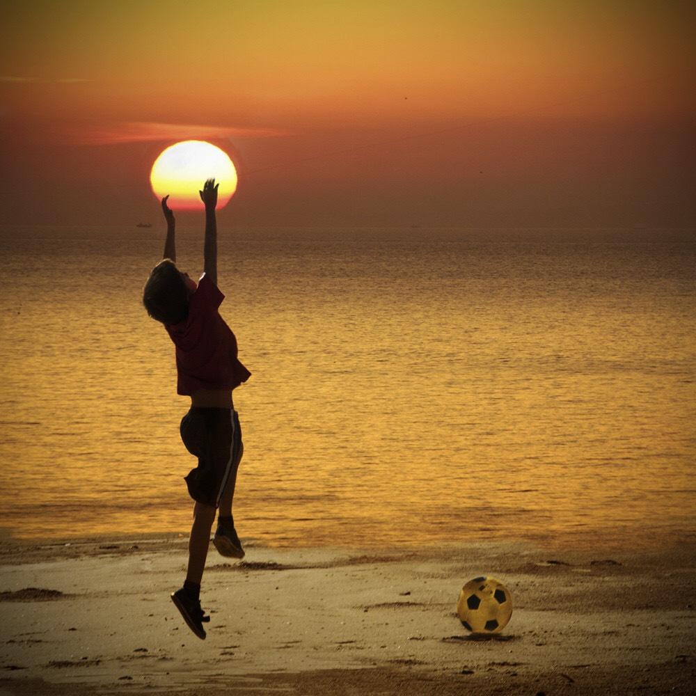 child hands sunset
